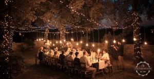 Tuscany wedding venue converted village evening lighting
