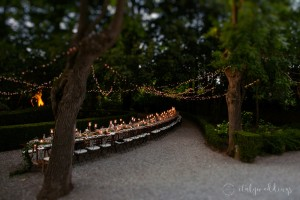 Siena Stomennano wedding evening fairy lights long country table