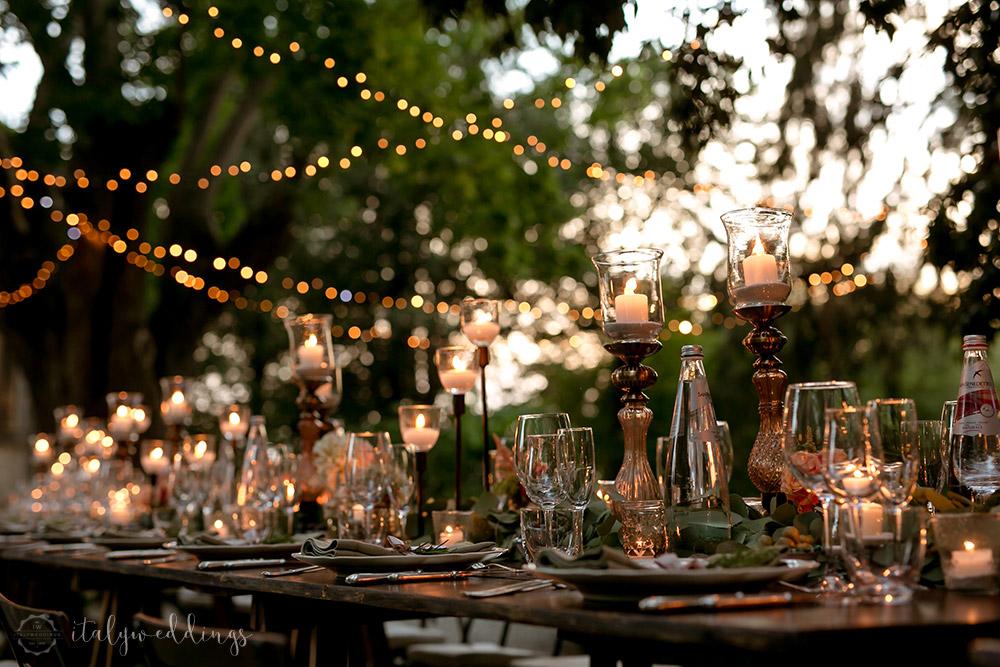 Siena Stomennano wedding evening fairy lights long country table