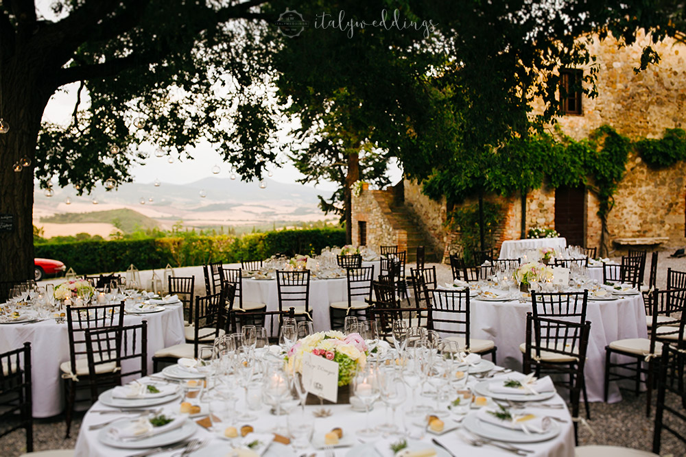 Castelvecchio Tuscany wedding table setup around tree
