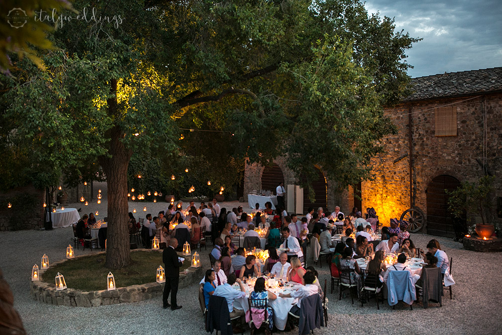 Castelvecchio Tuscany wedding table setup around tree with lanterns