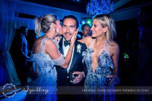 Italy wedding groom kiss