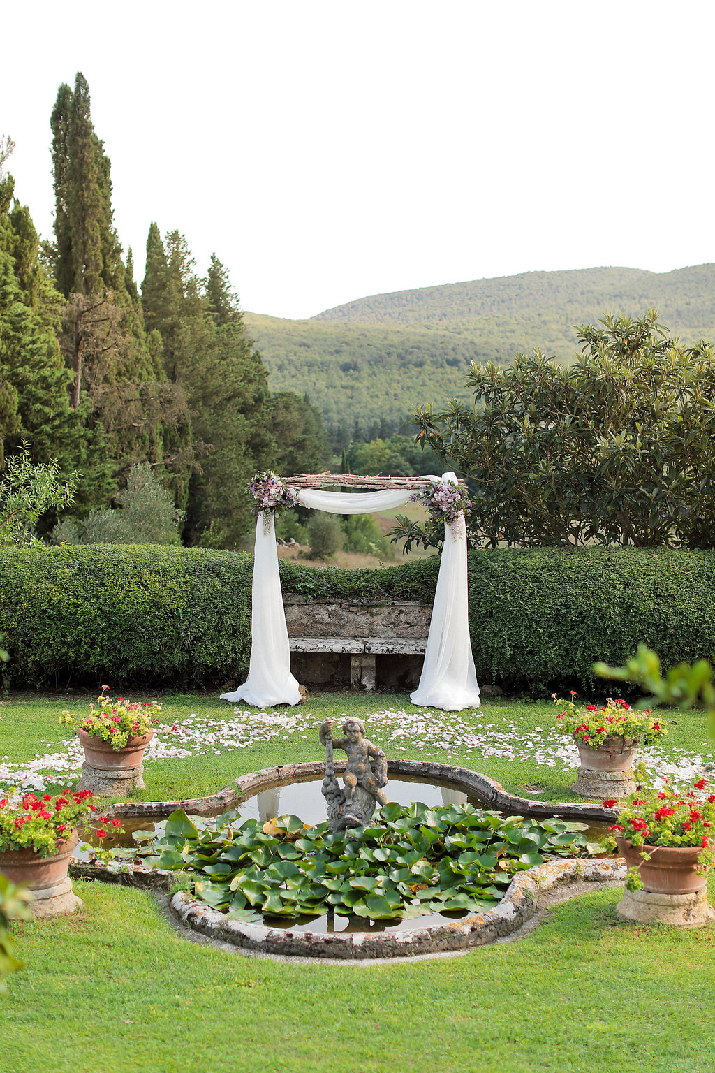 Luxury wedding blessing with secret garden lighting Tuscany arch