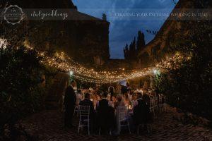 Civil wedding Montone reception Borgo Umbria fairy-light lighting